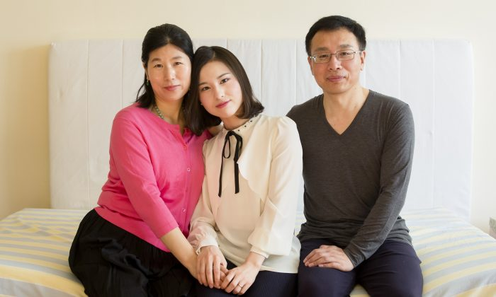 (L–R) Wang Huijuan, Li Fuyao, and Li Zhenjun at their home in Queens, New York, on Jan. 8, 2017. The family escaped China in 2014 and were granted asylum after enduring years of torture for practicing Falun Gong. (Samira Bouaou/Epoch Times)