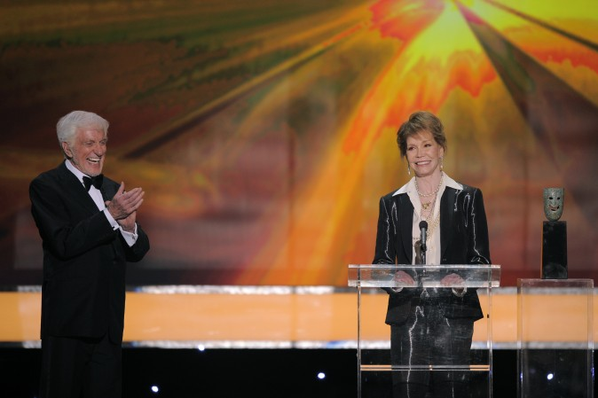 Dick Van Dyke presents the Life Achievement award onstage to Mary Tyler Moore at the 18th Annual Screen Actors Guild Awards in Los Angeles on Jan. 29, 2012. (AP Photo/Mark J. Terrill)