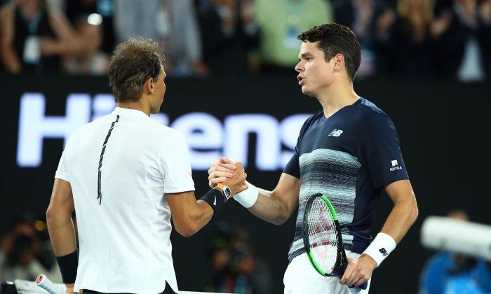 Milos Raonic congratulates Rafael Nadal on his Australian Open quarterfinal win on Jan. 25, 2017 in Melbourne, Australia. (Cameron Spencer/Getty Images)