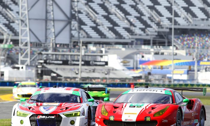 Alessando Balzan in the #63 Scuderia Corse Ferrari passes Andrew Davis in the #57 Stevenson Racing Audi during GTD-class qualifying for the 2017 Rolex 24. (Chris Jasurek/Epoch Times)
