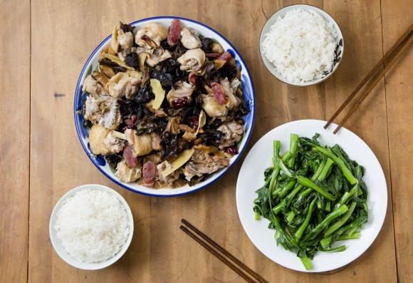 Steamed chicken with wood ear and shiitake mushrooms, served with rice and blanched choy sum. (Samira Bouaou/Epoch Times)