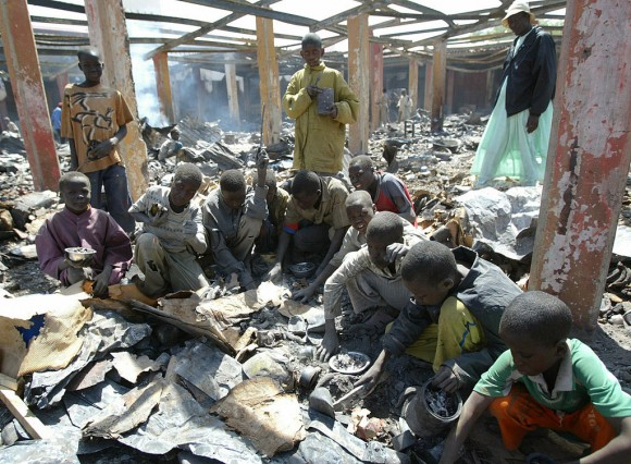 Children search for melted aluminium among ashes of a burnt central market during fighting between the Chadian army and insurgents on Feb. 9, 2008, in N'Djamena, Chad. Scrap aluminum is often used in Africa to make cooking pots, which release lead and other toxins into food, according to a study published in the February 2017 issue of the journal Science of the Total Environment. (Kambou Sia/AFP/Getty Images)