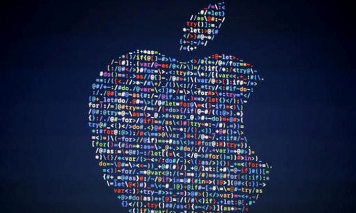 FILE - In this June 13, 2016 file photo, The Apple logo is shown on a screen at the Apple Worldwide Developers Conference in the Bill Graham Civic Auditorium, in San Francisco. Google, Apple and other tech giants expressed dismay over an executive order on immigration from President Donald Trump that bars nationals of seven Muslim-majority countries from entering the U.S. The U.S tech industry relies on foreign engineers and other technical experts for a sizeable percentage of its workforce. The order bars entry to the U.S. for anyone from Iran, Iraq, Libya, Somalia, Sudan, Syria and Yemen for 90 days.  (AP Photo/Tony Avelar, File)