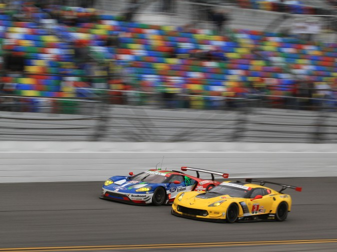 Olivier Pla in the #68 Ford and in the Jan Magnussen in the #3 Corvette duel on the front straight in the opening laps of the race. The battle has continued, with the addition of Ferrari. (Chris Jasurek/Epoch Times)