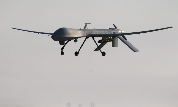 A U.S. Air Force MQ-1B Predator unmanned aerial vehicle (UAV), carrying a Hellfire missile lands at a secret air base after flying a mission in the Persian Gulf region on Jan. 7, 2016. (John Moore/Getty Images)