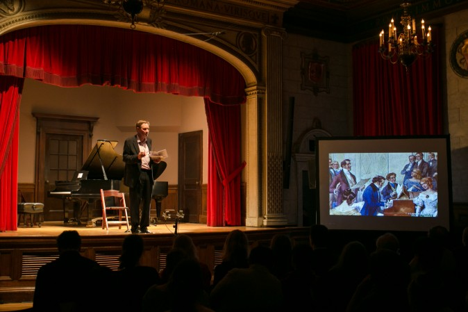 Writer Stephen Johnson gives his notes on Franz Schubert during a concert spanning a century of Romanticism in Vienna, at Columbia University in New York on Jan. 26. (Benjamin Chasteen/Epoch Times)