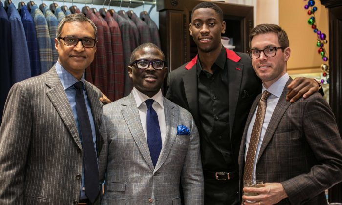 Brand ambassador Brooklyn Net Caris LeVert (C) along with attending guests at the Eredi Pisanò boutique event which is celebrating 15 years on Madison Avenue in New York on Dec. 21, 2016. (Benjamin Chasteen/Epoch Times)
