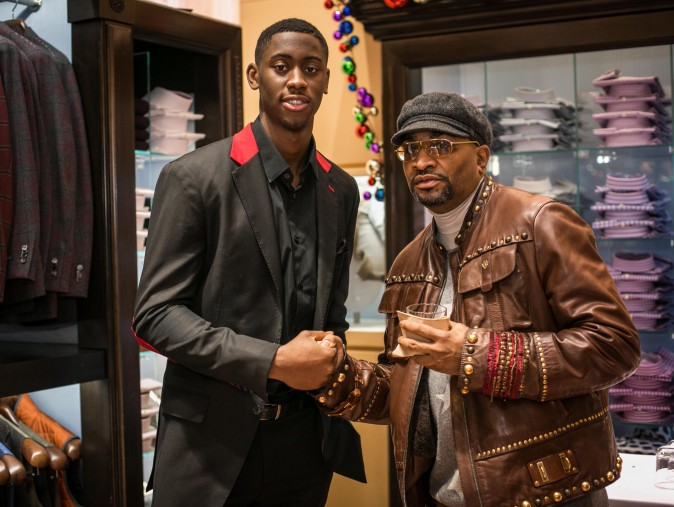 Brand ambassador Brooklyn Net Caris LeVert (L) at the Eredi Pisanò boutique event which was celebrating 15 years on Madison Avenue in New York on Dec. 21, 2016. (Benjamin Chasteen/Epoch Times)