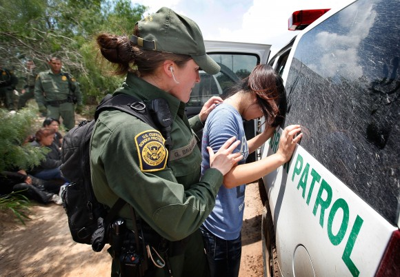 A Border Patrol agent searches an illegal immigrant apprehended near the Mexican border near McAllen, Texas, in 2010. The vast majority of undocumented immigrants cross over the southern border. (Scott Olson/Getty Images)
