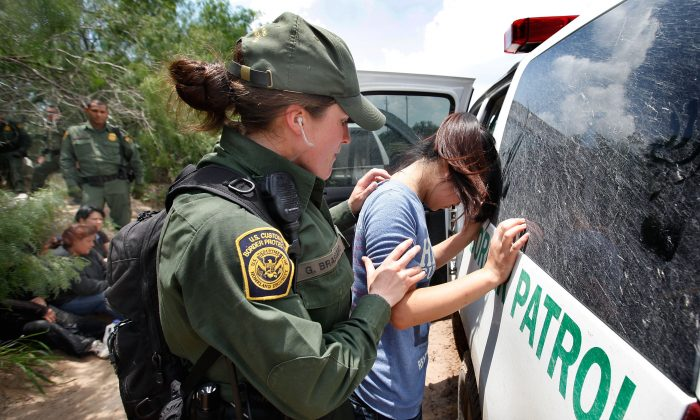 A Border Patrol agent searches an illegal immigrant apprehended near the Mexican border near McAllen, Texas, in this file photo. (Scott Olson/Getty Images)