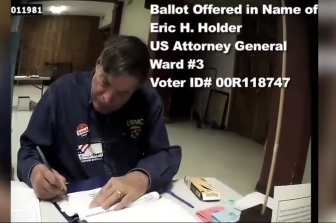 A screenshot by Project Veritas shows a person using an undercover camera walking into a polling station who was approved to vote by using Attorney General Eric Holder's name and address. (Screenshot via Youtube/Project Veritas)