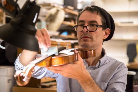 Michael Bourassa at the restoration shop of Rare Violins of New York in Manhattan, New York, on Jan. 9, 2017. (Samira Bouaou/Epoch Times)