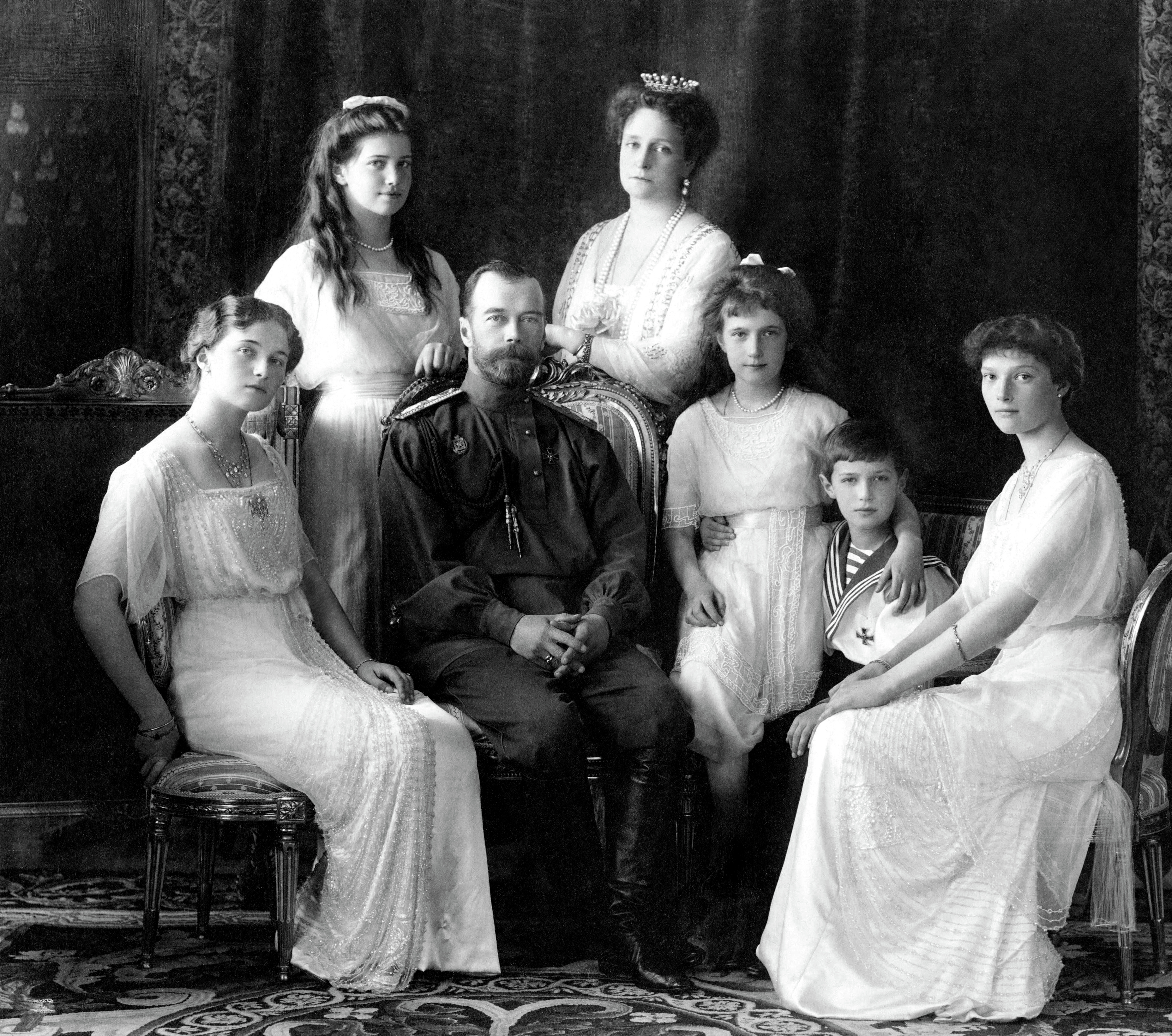 Czar Nicholas II in 1913 with his empress, Alexandra, and their children. In 1918, they were murdered by their communist captors. (Public Domain)
