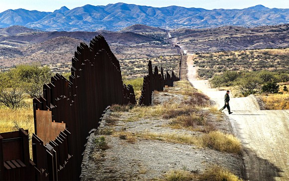 A U.S. Border Patrol agent looks for footprints of illegal immigrants crossing the U.S.–Mexico border near Nogales, Arizona, in 2010. On Jan. 25, President Donald Trump ordered a continuous physical wall be constructed along the southern border. (John Moore/Getty Images)