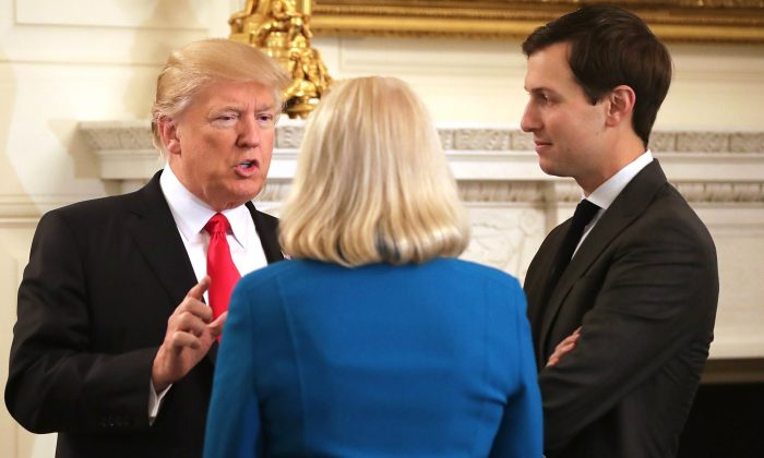 President Donald Trump (L) and his son-in-law and Senior Advisor Jared Kushner (R) talk with IBM CEO Ginni Rometty at the beginning of a policy forum in the State Dining Room at the White House in Washington on Feb. 3, 2017. (Chip Somodevilla/Getty Images)
