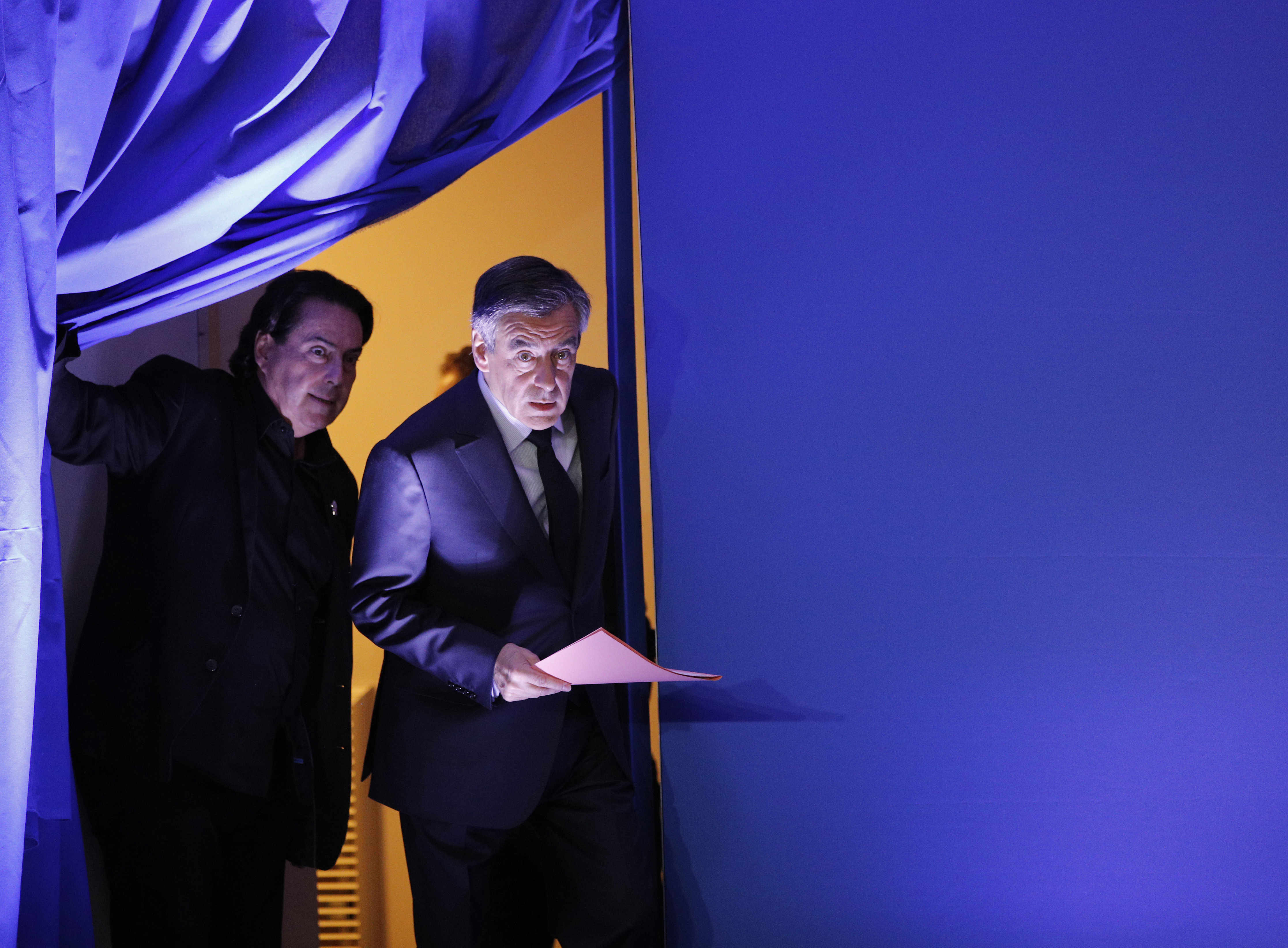 French conservative Francois Fillon (R) arrives on stage to hold a press conference at his campaign headquarters in Paris, France on Feb. 6, 2017. (AP Photo/Christophe Ena)