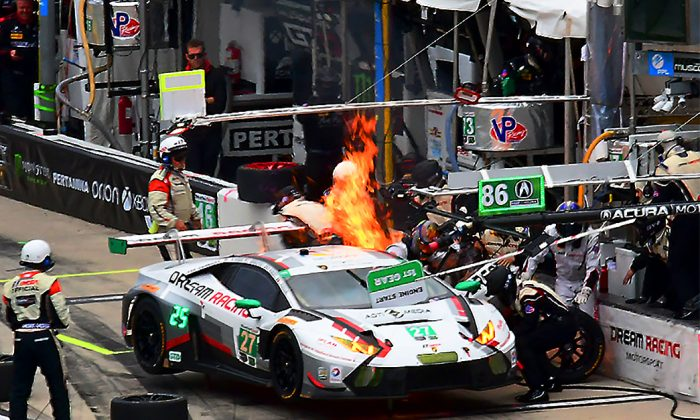 The #27 Dream Racing Lamborghini Huracan bursts into flame during its first pit stop at the IMSA WeatherTech Sportscar Championship Rolex 24 at Daytona, Jan 28, 2017. No one was injured. (Bill Kent/Epoch Times)