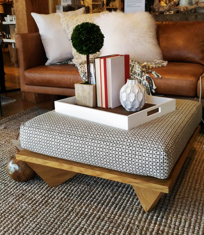 A cushioned coffee table can double as extra seating or as a footstool. (Epoch Times)