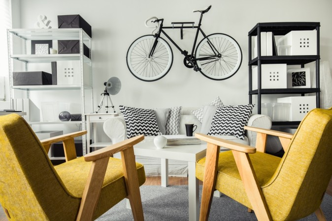 Storing a bicycle on the wall is aesthetically pleasing and also frees up floor space. (Photographee.eu/Shutterstock)
