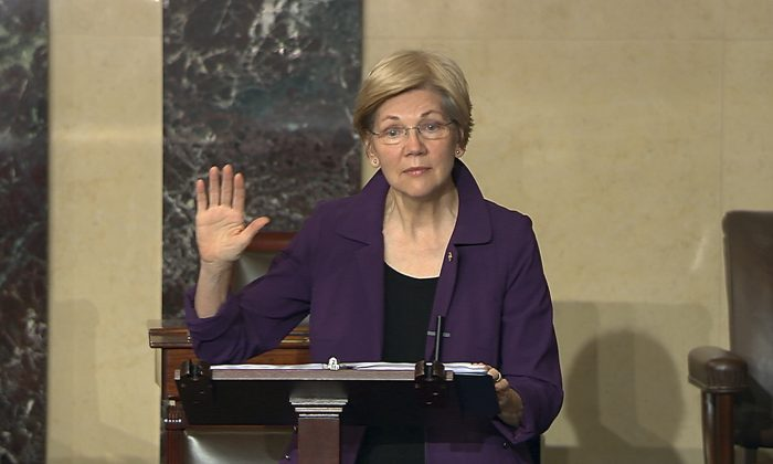 In this image from Senate Television, Sen. Elizabeth Warren, D-Mass., speaks on the floor of the U.S. Senate in Washington, Feb. 6, 2017, about the nomination of Betsy DeVos to be Education Secretary. The Senate will be in session around the clock this week as Republicans aim to confirm more of President Donald Trump's Cabinet picks over Democratic opposition. (Senate TV via AP)