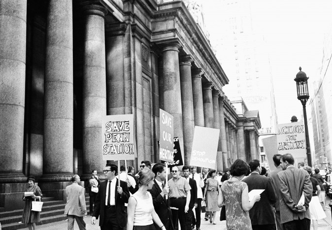 People picket Pennsylvania Station in New York on Aug. 2, 1962, in protest over plans to tear it down and build an office building on the site.  (AP Photo/Marty Lederhandler)