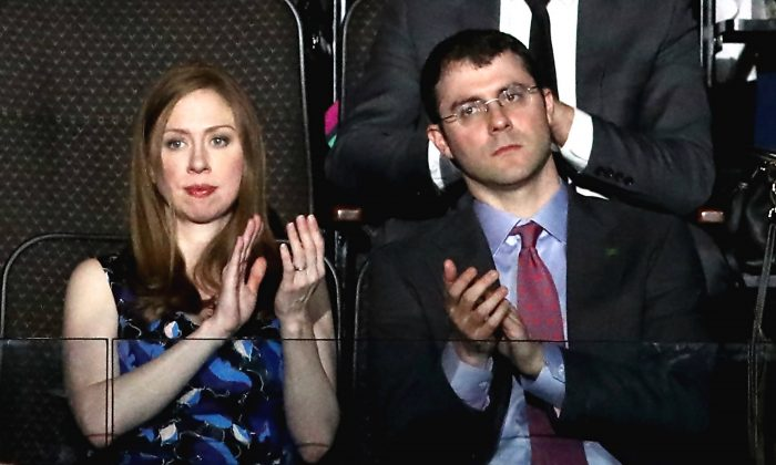 Chelsea Clinton and along with her husband Marc Mezvinsky clap as they listen to speakers on the second day of the Democratic National Convention at the Wells Fargo Center in Philadelphia, Pennsylvania on July 26, 2016. (Win McNamee/Getty Images)