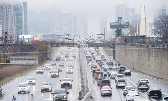 Vehicles makes their way into and out of downtown Toronto along the Gardiner Expressway in Toronto. New toll roads are often cited as important infrastructure improvements in Canada. (The Canadian Press/Nathan Denette)