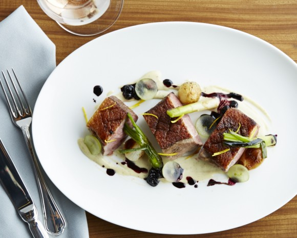 Seared duck breast with red currant sauce, garlic-pine nut emulsion, and pearl onions. (Armando Rafael)