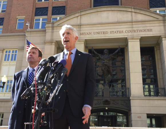 Virginia Attorney General Mark Herring, right, accompanied by Virginia Solicitor General Stuart Raphael, speaks outside the federal courthouse in Alexandria, Va. on Feb. 10, 2017, following a hearing on President Donald Trump's travel ban. (AP Photo/Jessica Gresko)