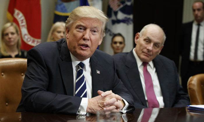 Homeland Security Secretary John Kelly listens at right as President Donald Trump speaks during a meeting on cyber security in the Roosevelt Room of the White House in Washington, Tuesday, Jan. 31, 2017. (AP Photo/Evan Vucci)