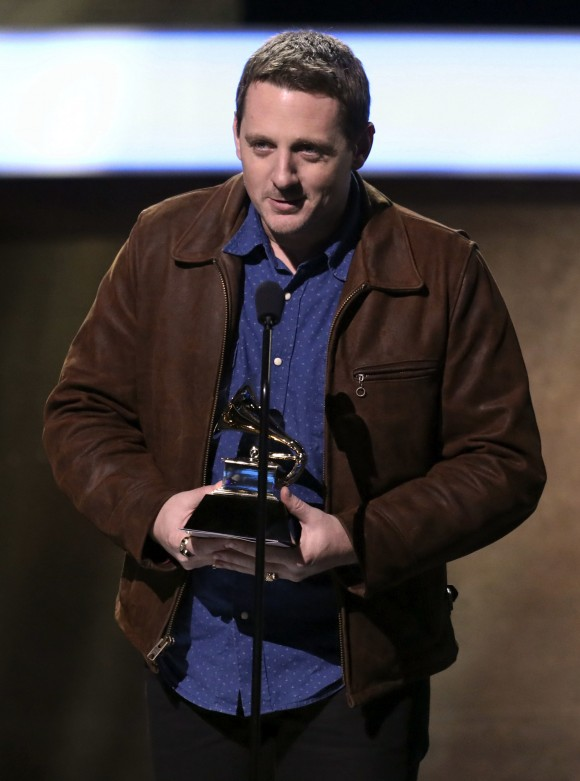 """Sturgill Simpson accepts the award for best country album for """"A Sailor's Guide To Earth"""" at the 59th annual Grammy Awards on Sunday, Feb. 12, 2017, in Los Angeles. (Photo by Matt Sayles/Invision/AP)"""