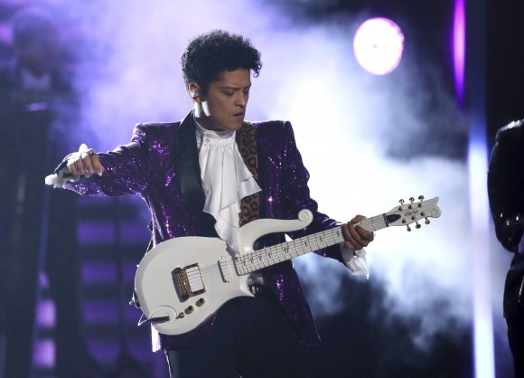 """Bruno Mars performs """"Let's Go Crazy"""" during a tribute to Prince at the 59th annual Grammy Awards on Sunday, Feb. 12, 2017, in Los Angeles. (Photo by Matt Sayles/Invision/AP)"""