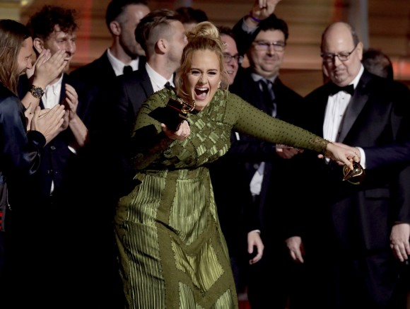 """Adele accepts the award for album of the year for """"25"""" at the 59th annual Grammy Awards on Sunday, Feb. 12, 2017, in Los Angeles. (Photo by Matt Sayles/Invision/AP)"""