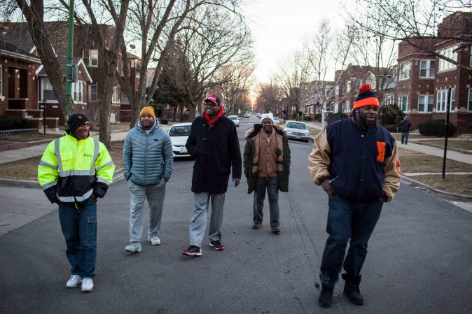 The guys from CeaseFire walk down a street in the South Side of Chicago's Auburn Gresham neighborhood on Feb. 3, 2017. (Petr Svab/Epoch Times)