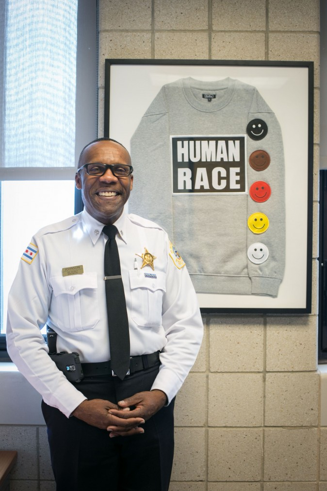 Commander Kenneth Johnson of the District 7 Chicago Police Station in Englewood, Chicago, on Feb. 2, 2017, with a sweater he purchased at a street fair. (Benjamin Chasteen/Epoch Times)