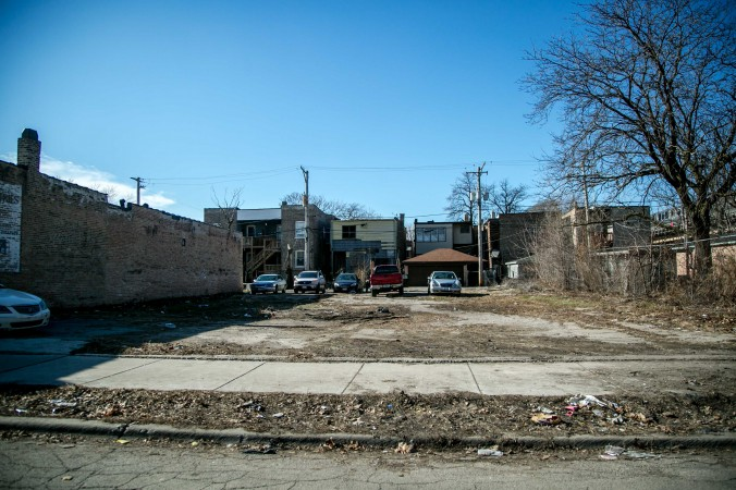 An empty lot the Englewood neighborhood of Chicago, on Feb. 2, 2017. In an incentive to encourage new businesses to come in, the city is selling empty lots for one dollar if you happen to live on the same block.  (Benjamin Chasteen/Epoch Times)
