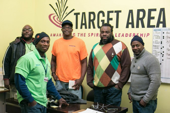 (R-L) Mike Nash, Joe Washington, Charlie Jones, John Hardy, and Thomas Jefferson, who all work for CeaseFire at the Target Area Development office in the Auburn Gresham neighborhood of Chicago on Feb. 2, 2017. (Benjamin Chasteen/Epoch Times)