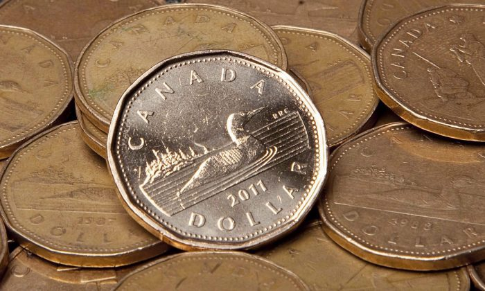 The Canadian dollar has been on a steady climb since the end of 2016, while the price of oil is little changed. (The Canadian Press/Jonathan Hayward)