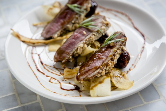 Duck breast with nduja-stuffed dates, pekmez syrup, and parsnip. (Samira Bouaou/Epoch Times)