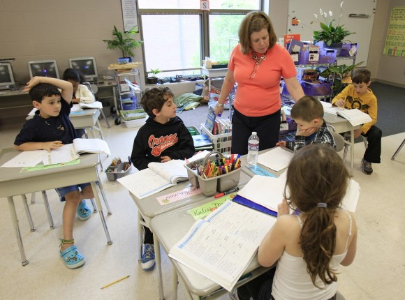 A teacher with her second graders at Moreland Hills Elementary School in Pepper Pike, Ohio, on May 8, 2012. (AP Photo/Tony Dejak)