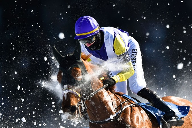 Fabris Jindrich with his horse Hello Goodby competes during the flat race of the White Turf horse racing event in St. Moritz, Switzerland, on Feb. 19, 2017. The races are held on the frozen lake of the Swiss mountain resort. (MICHAEL BUHOLZER/AFP/Getty Images)