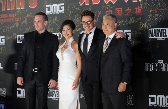 Robert Downey Jr. with CEO of DMG Dan Mintz (L), DMG president Wu Bing (2nd L) and DMG chairman Xiao Wenge (R) as they attend a promotional event for  ''Iron Man 3'' in Beijing on April 3, 2013. (WANG ZHAO/AFP/Getty Images)