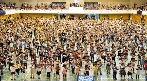 Children play the violin during the opening concert of the 16th Suzuki Method World Convention in Matsumoto, about 240 km northwest of Tokyo on March 28, 2013. (KAZUHIRO NOGI/AFP/Getty Images)