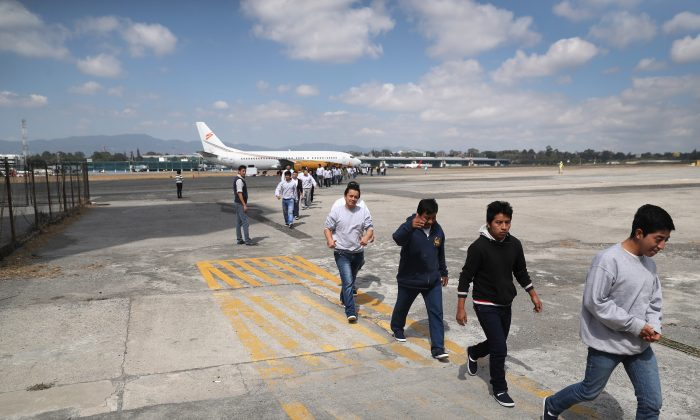 Guatemalan immigrants deported from the United States arrive on an ICE deportation flight in Guatemala City, on Feb. 9, 2017. (John Moore/Getty Images)