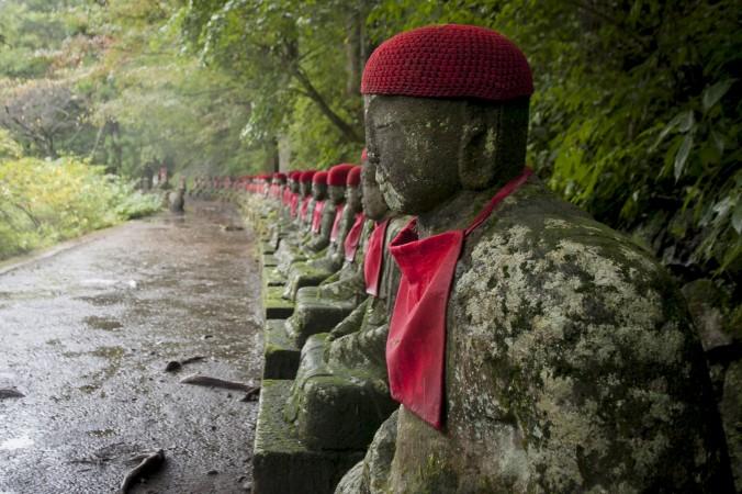 Jizo Buddha statues lined up along the Kanman-ga-fuchi Abyss gorge in Nikko. (Annie Wu/Epoch Times)