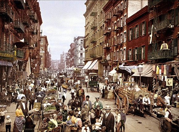 Mulberry Street market in New York in the early 1900s. Manhattan's Little Italy is a classic example of how immigrants from the same nation settled in clusters in their new land. (Library of Congress)