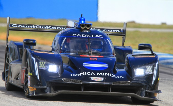 Ricky Taylor in the #10 WTR Cadillac DPi rounds Turn Ten. Brother Jordan scored the quickest lap of the third session. (Chris Jasurek/Epoch Times)