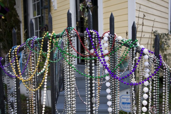 Mardi Gras beads adorn a gate in New Orleans. (Derek Bridges CC by 2.0)