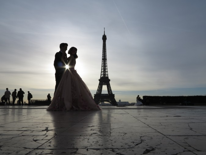 A young couple who just got married, make wedding pictures in front of the Eiffel tower, at sunrise at the trocadero in Paris on Feb. 25. (LUDOVIC MARIN/AFP/Getty Images)