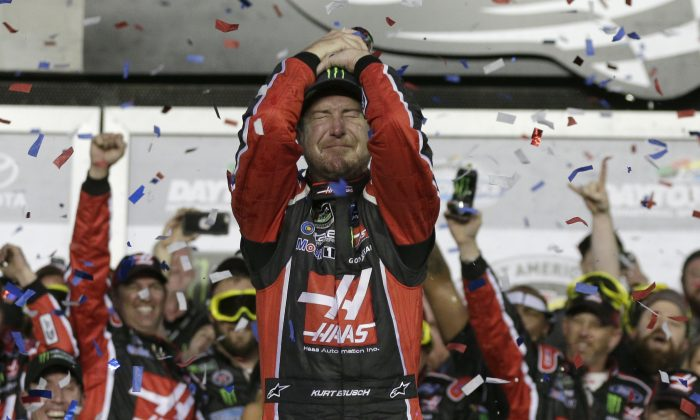 Kurt Busch celebrates in Victory Lane after winning the NASCAR Daytona 500 auto race at Daytona International Speedway in Daytona Beach, Fla. on Feb. 26, 2017. (AP Photo/Chuck Burton)